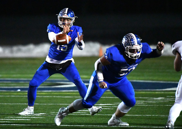 12/4/2019 Mike Orazzi | StaffrSouthingtons Brady Lafferty (15) during the Class LL football playoff with Ridgefield at Southington High School on Wednesday night.
