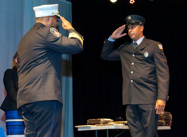 09/20/18 Wesley Bunnell | Staff The New Britain Fire Department held their 2018 Awards Ceremony on Thursday September 20 at Trinity on Main. Firefighter Alexander Ugarte salutes Fire Chief Raul Ortiz during the badge pinning ceremony.