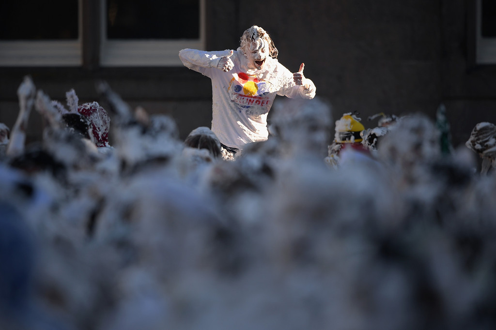 . Students from St Andrew\'s University indulge in a tradition of covering themselves with foam to honor the \'academic family\' on November 4, 2013, in St Andrews, Scotland.   (Photo by Jeff J Mitchell/Getty Images)
