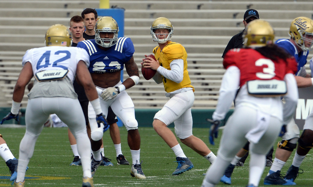 . UCLA Bruins quarterback Jerry Neuheisel (11) during a NCAA college spring football game at the Rose Bowl in Pasadena, Calif., Saturday, April 25, 2015.