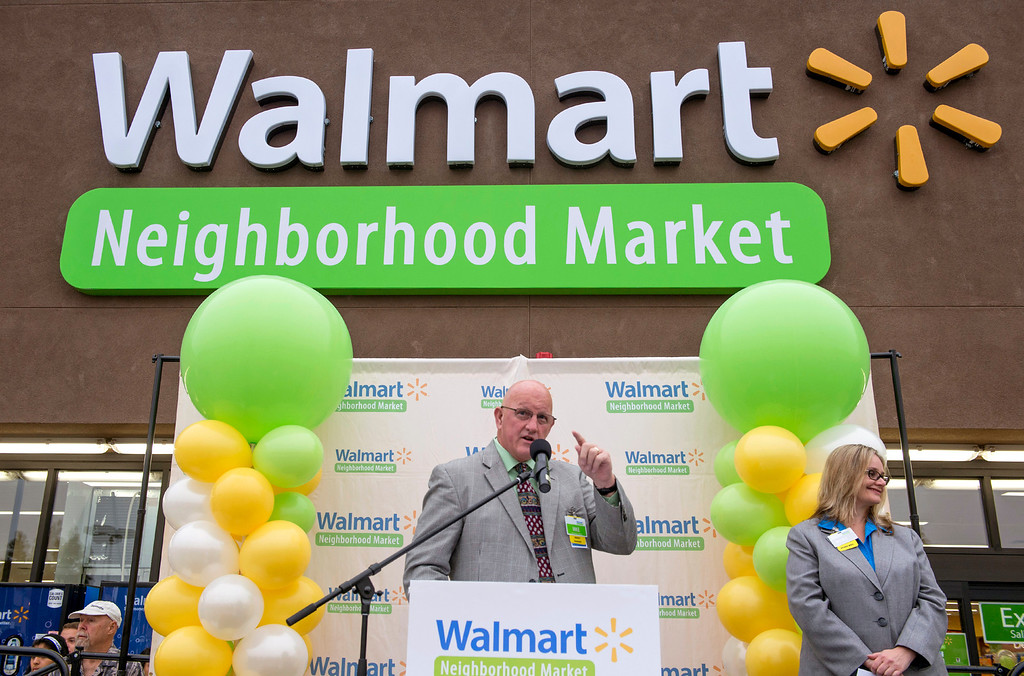 . Walmart market manager Mike Acheson speaks during the grand opening of Walmart Neighborhood Market at 1425 N. Hacienda Boulevard in La Puente, Calif. October 2, 2013.  (Staff photo by Leo Jarzomb/SGV Tribune)