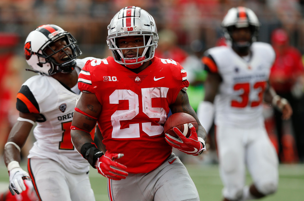 . Ohio State running back Mike Weber scores a touchdown against Oregon State during the second half of an NCAA college football game Saturday, Sept. 1, 2018, in Columbus, Ohio. Ohio State beat Oregon State 77-31. (AP Photo/Jay LaPrete)