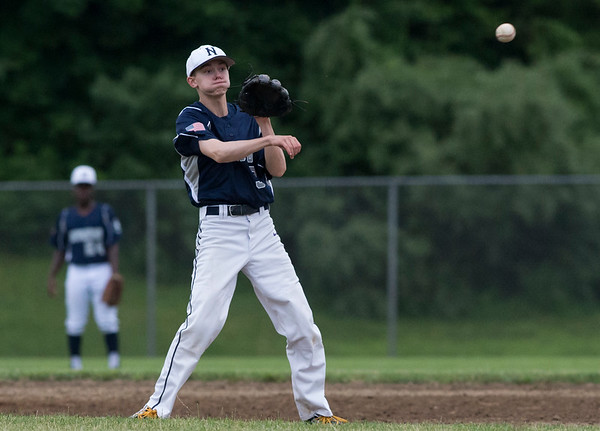 06/19/19 Wesley Bunnell   Staff Berlin Legion vs Newington at Legends Field in Newington on June 19, 2019. Newington's Samuel Dionne (3) fields and throws to first for the out.