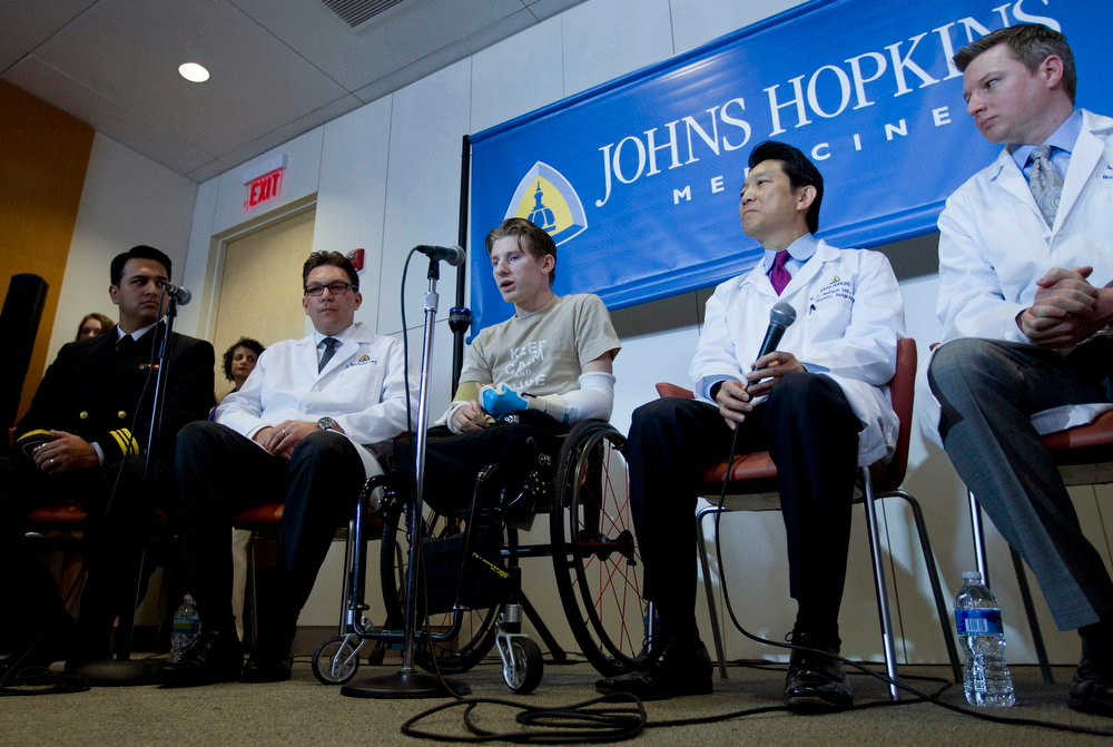 . U.S. Army Sgt. Brendan Marrocco (C) of Staten Island, New York, who lost his four limbs in a 2009 roadside bomb attack in Iraq, speaks during a news conference after receiving double arm transplants, performed by a Hopkins medical team at The John Hopkins Hospital, in Baltimore, Maryland January 29, 2013. With him are: (L-R) U.S. Navy Lieutenant Commander Patrick L. Basile at Walter Reed National Military Medical Center, Johns Hopkins Medicine\'s Vascularized Composite Allotransplantation Program Scientific Director Gerald Brandacher, Johns Hopkins School of Medicine\'s Department of Plastic and Reconstructive Surgery Director W.P. Andrew Lee, and Plastic and Reconstructive Surgery Assistant Professor Jaimie Shores. REUTERS/Jose Luis Magana