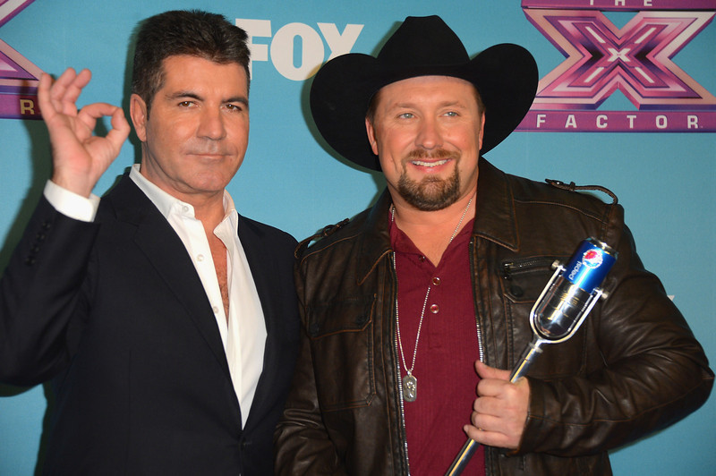 ". Producer Simon Cowell and season 2 winner Tate Stevens celebrate at Fox\'s ""The X Factor\"" Season Finale - Night 2 at CBS Televison City on December 20, 2012 in Los Angeles, California.  (Photo by Frazer Harrison/Getty Images)"