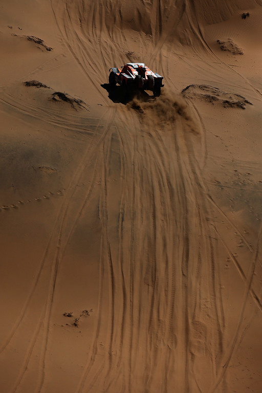 . COPIAPO, CHILE - JANUARY 07:  #320 Ronan Chabot et Gilles Pillot of France for Toy Motors SMG compete during day 4 of the Dakar Rallly on January 7, 2015 between Chilecito in Argentina to Copiapo, Chile.  (Photo by Dean Mouhtaropoulos/Getty Images)