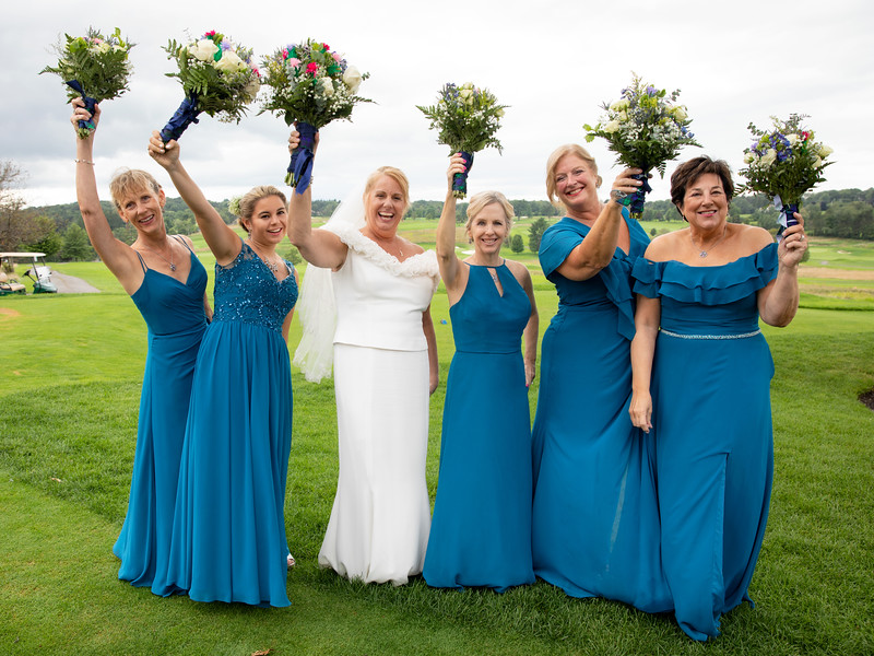 Bride and Bridesmaids holding Bouquets.jpg