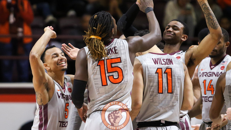 Justin Robinson (left) smiles as he runs out from the bench to high five his teammates after UMES calls a timeout. (Mark Umansky/TheKeyPlay.com)