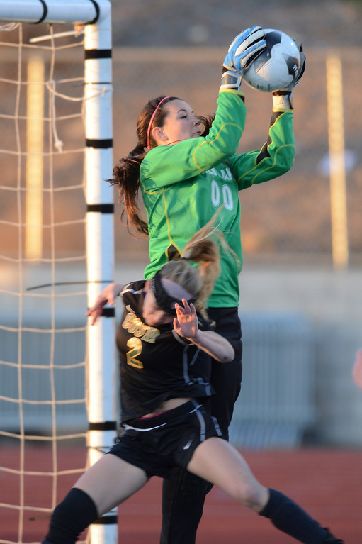 . Westlake\'s Maddie Gurewitz makes a save as Mira Costa\'s Kimby Keever tries for the header.  Westlake defeated Mira Costa 1-0 in the quarterfinal.  Photo by David Crane/Staff Photographer