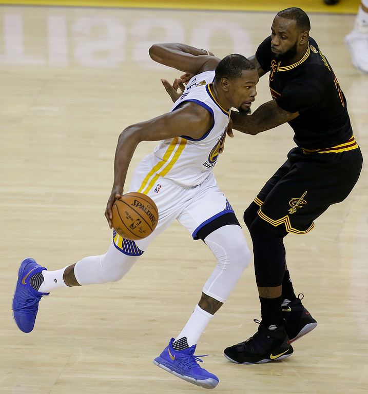 . Golden State Warriors forward Kevin Durant, left, drives on Cleveland Cavaliers forward LeBron James during the second half of Game 2 of basketball\'s NBA Finals in Oakland, Calif., Sunday, June 4, 2017. (AP Photo/Ben Margot)
