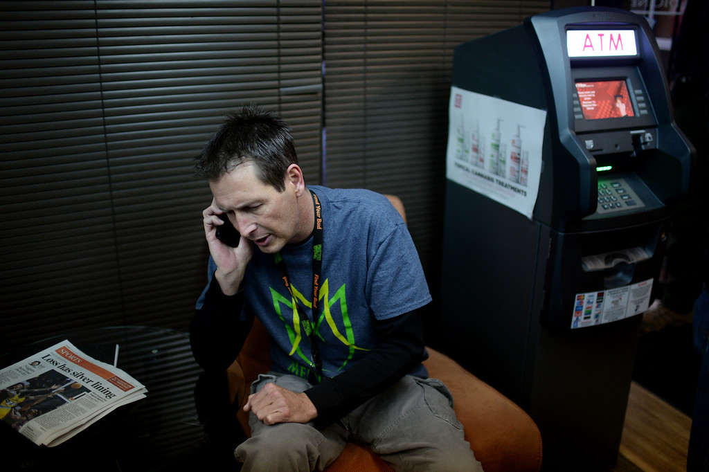 . DENVER, CO. JANUARY 01: Pete Williams, chief operating officer of Medicine Man, makes a phone call at Medicine Man marijuana dispensary on New Years day morning in Denver, Colorado January 1, 2014. (Photo by Hyoung Chang/The Denver Post)