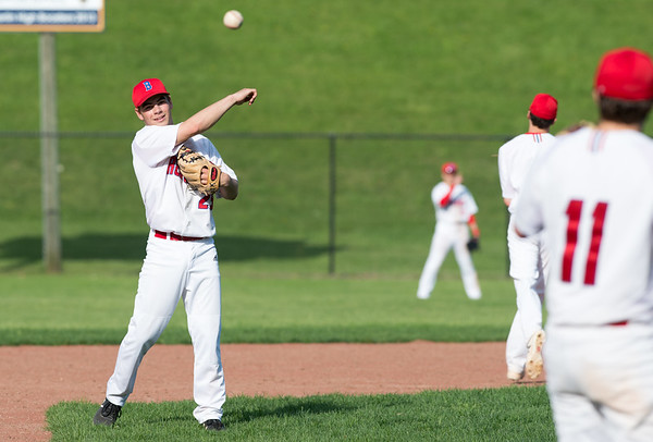 05/6/19 Wesley Bunnell | Staff Berlin baseball defeated Bristol Eastern at Sage Park on Tuesday afternoon. DanVeleas (25) throws to Jeff Kuzoian (11) between innings.