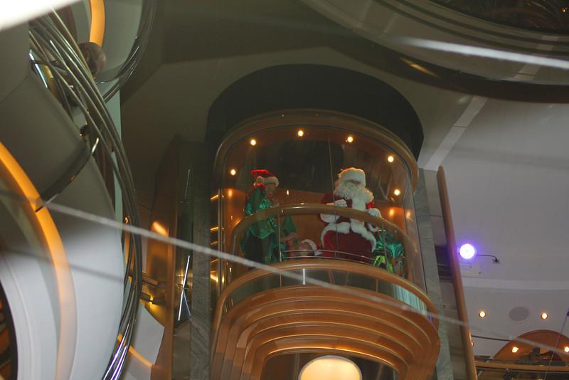 Santa descends on the elevator