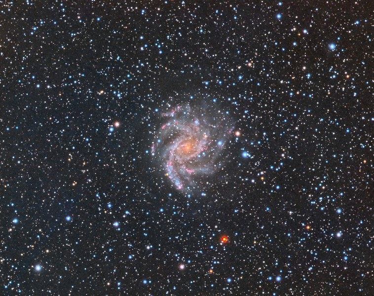 """NGC6946: Fireworks Galaxy. RGB. 0.96""""/pixel image scale.  Astrodon Red filter,  10 x 10 minutes, 1x1. 8/15/2014.  Astrodon Green filter, 10 x 10 minutes, 1x1. 8/15/2014.   Astrodon Blue filter, 10 x 10 minutes, 1x1. 8/15/2014.    TEC 140 APO F/7 with Astro-Physics A-P1100GTO GEM. QSI660wsg. Guided with A-P Vario Finder 250mm focal length and Superstar, Optec Handy Stepper Motor focuser.   Captured and automated with SGP. Calibration (including Dark Subtraction) and Post-processed with PixInsight. PHD2 settings: RA Aggressiveness: 60, RA Hysteresis: 10, Max RA/Dec Duration: 1000, Min Motion: 0.10, Calibration Steps: 550msec, Auto/Resist Switching, Extreme dithering and Settle at < 0.4, 1 sec guiding exposure."""