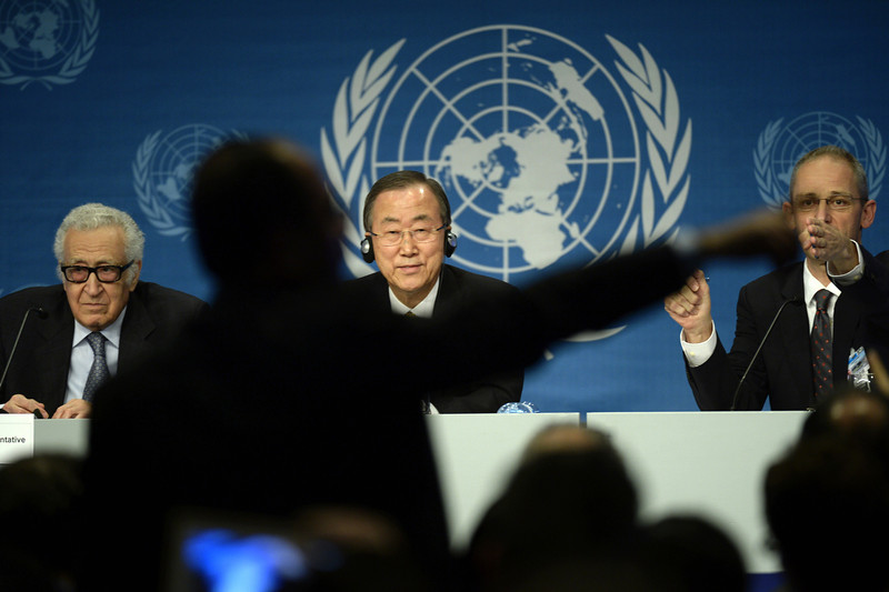 . A journalist tries to ask a question to UN Secretary General Ban Ki-Moon (C) as his spokesman Martin Nesirky (R) gestures during a press conference closing the so-called Geneva II peace talks dedicated to the ongoing conflict in Syria, on January 22, 2014, in Montreux. UN leader told Syria\'s warring sides that the time had come for negotiations to end the country\'s bloodshed, in closing remarks at a peace conference in Switzerland. UN-Arab League envoy for Syria Lakhdar Brahimi is seen on left. (PHILIPPE DESMAZES/AFP/Getty Images)