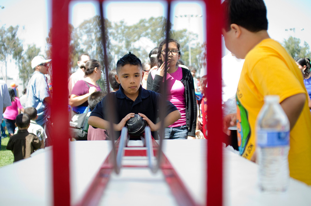 . Zayd Ceron, 9, of Whittier plays a game during the first Easter Land event at Mayberry Park in South Whittier, Calif. Saturday, March 20, 2013. An Easter egg hunt, food, games and music were made available for attendees. (SGVN/Correspondent photo by Anibal Ortiz)