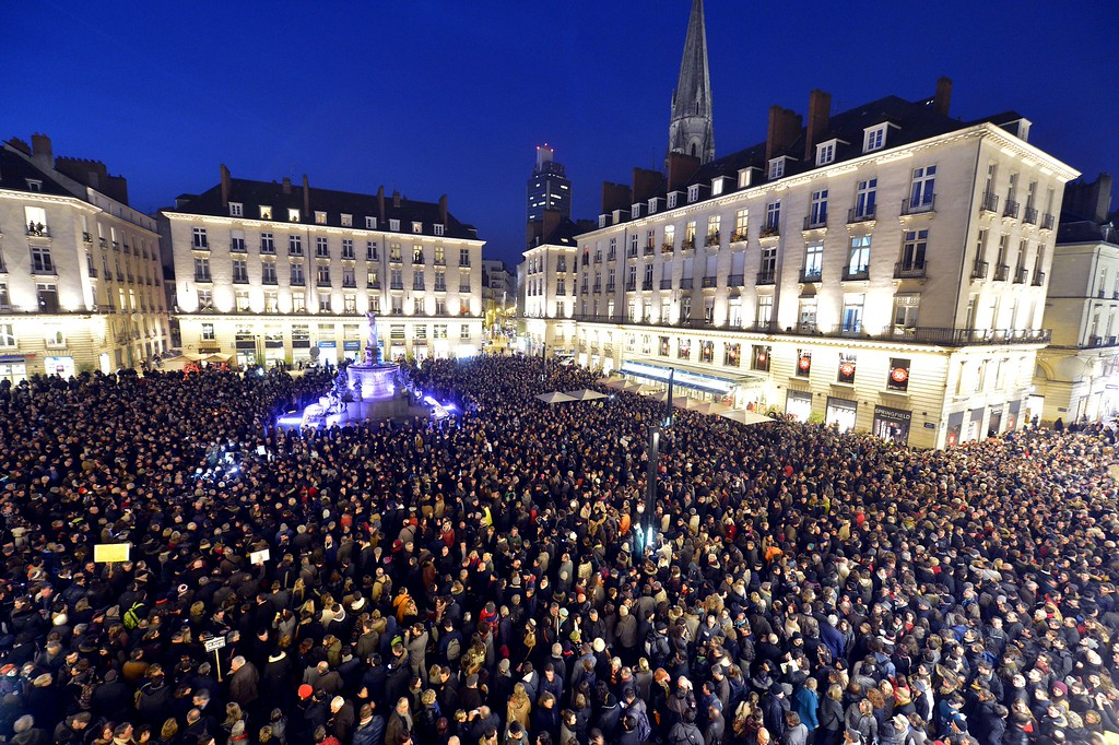. People gather at the Place Royale in Nantes on January 7, 2015, to show their solidarity for the victims of the attack by unknown gunmen on the offices of the satirical weekly, Charlie Hebdo. Heavily armed gunmen massacred 12 people on Wednesday after bursting into the Paris offices of a satirical weekly that had long outraged Muslims with controversial cartoons of the prophet Mohammed. AFP PHOTO GEORGES GOBET/AFP/Getty Images