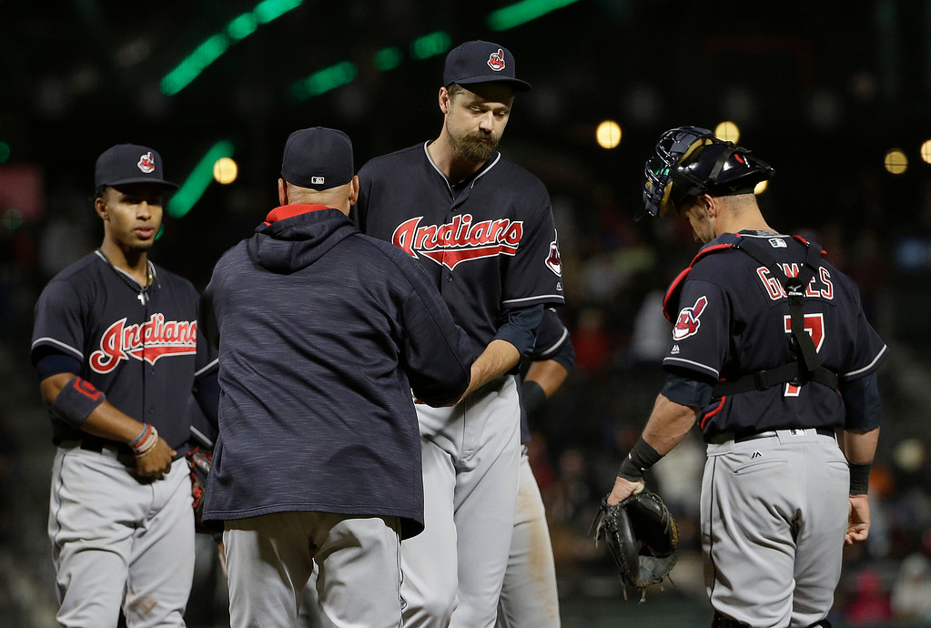 . Cleveland Indians pitcher Andrew Miller, center right, hands the ball to manager Terry Francona as he is relieved during the ninth inning of a baseball game against the San Francisco Giants in San Francisco, Tuesday, July 18, 2017. The Giants won 2-1 in ten innings. (AP Photo/Jeff Chiu)