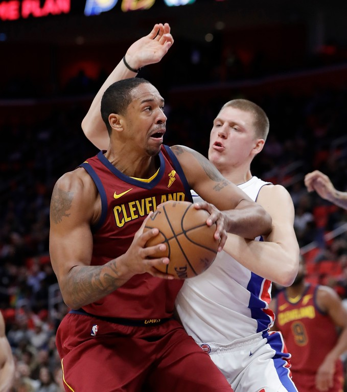. Cleveland Cavaliers forward Channing Frye runs into the defense of Detroit Pistons forward Henry Ellenson during the second half of an NBA basketball game, Monday, Nov. 20, 2017, in Detroit. (AP Photo/Carlos Osorio)