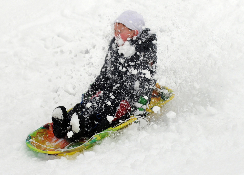 . Joseph Pankey, 6, sleds through the snow at Schadt Park in Silvis, Ill., on Tuesday, March 5, 2013. (AP Photo/The Dispatch, Todd Mizener)