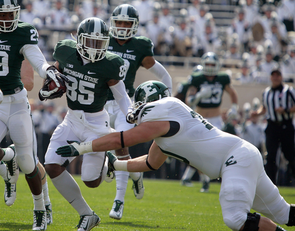 . Michigan State\'s Macgarrett Kings Jr. (85) runs back a punt against Eastern Michigan\'s Matt Thornton during the first quarter of an NCAA college football game, Saturday, Sept. 20, 2014, in East Lansing, Mich. (AP Photo/Al Goldis)