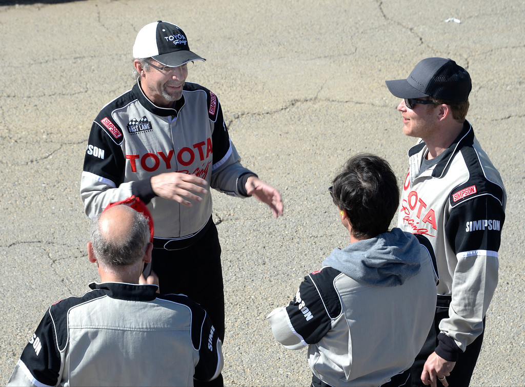 . March 15,2014. Rosamond CA. Former NASCAR racer Kyle Petty(L) talks with fellow celebrities on their racing skills as as they practice racing for the upcoming Long Beach Grand Prix with instructors in Toyota race cars at the Willow Springs International Raceway Saturday. Photo  by Gene Blevins/LA DailyNews