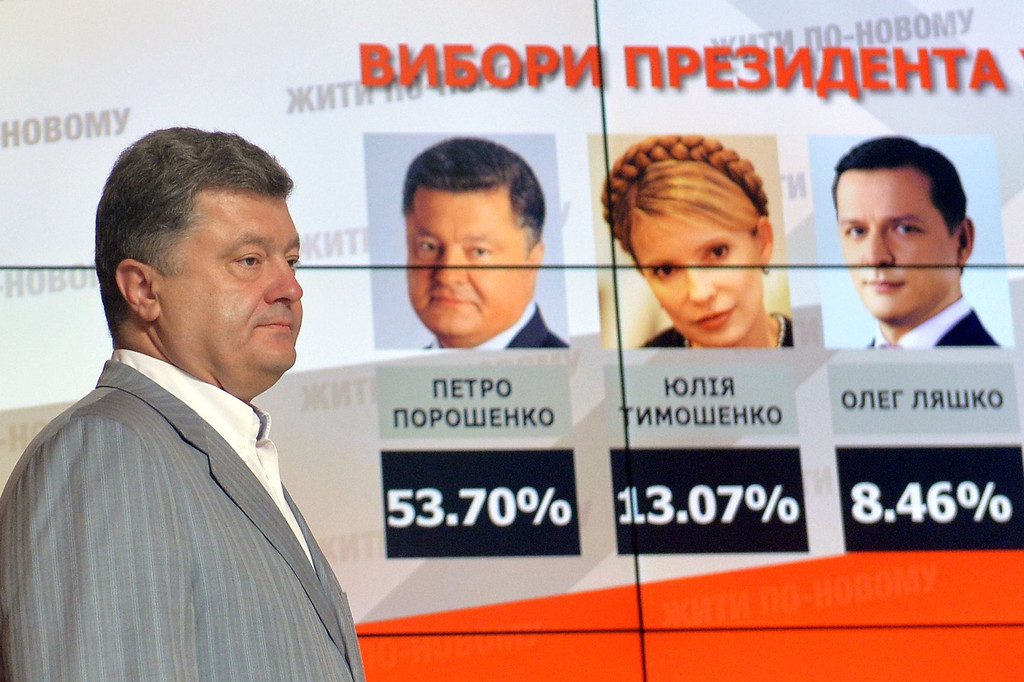 """. Presidential candidate Petro Poroshenko walks in front of screen displaying results of the presidential elections in Ukraine prior his press-conference in Kiev on May 26, 2014. Billionaire Petro Poroshenko said Monday after claiming victory in Ukraine\'s presidential election that he wanted to continue the military offensive in the separatist east but also to make it more \""""efficient\"""". \""""I support continuing the operation, but I demand that its format be changed,\"""" Poroshenko told reporters a day after Ukraine\'s presidential vote. \""""It must be shorter in terms of time-frames and more efficient\"""".   SERGEI SUPINSKY/AFP/Getty Images"""