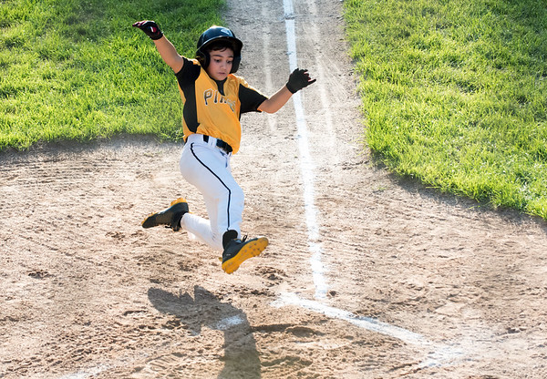 08/23/18 Wesley Bunnell | Staff The Forestville Pirates vs the Edgewood Cubs in the Bristol Little League City Series on Thursday evening at Frazier Field. The Pirate's Alex Maldonado (5) scores the first run of the game sliding cleanly into home plate.