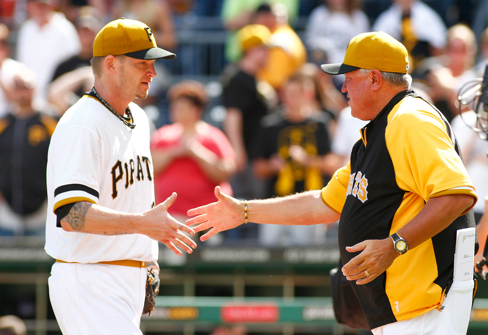 . A.J. Burnett #34 of the Pittsburgh Pirates celebrates with manager Clint Hurdle #13 after throwing a complete game against the Colorado Rockies on August 4, 2013 at PNC Park in Pittsburgh, Pennsylvania.  (Photo by Justin K. Aller/Getty Images)