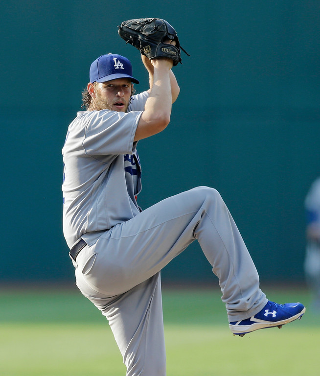 . Los Angeles Dodgers starting pitcher Clayton Kershaw winds up during the first inning of the team\'s baseball game against the Cleveland Indians, Tuesday, June 13, 2017, in Cleveland. (AP Photo/Tony Dejak)