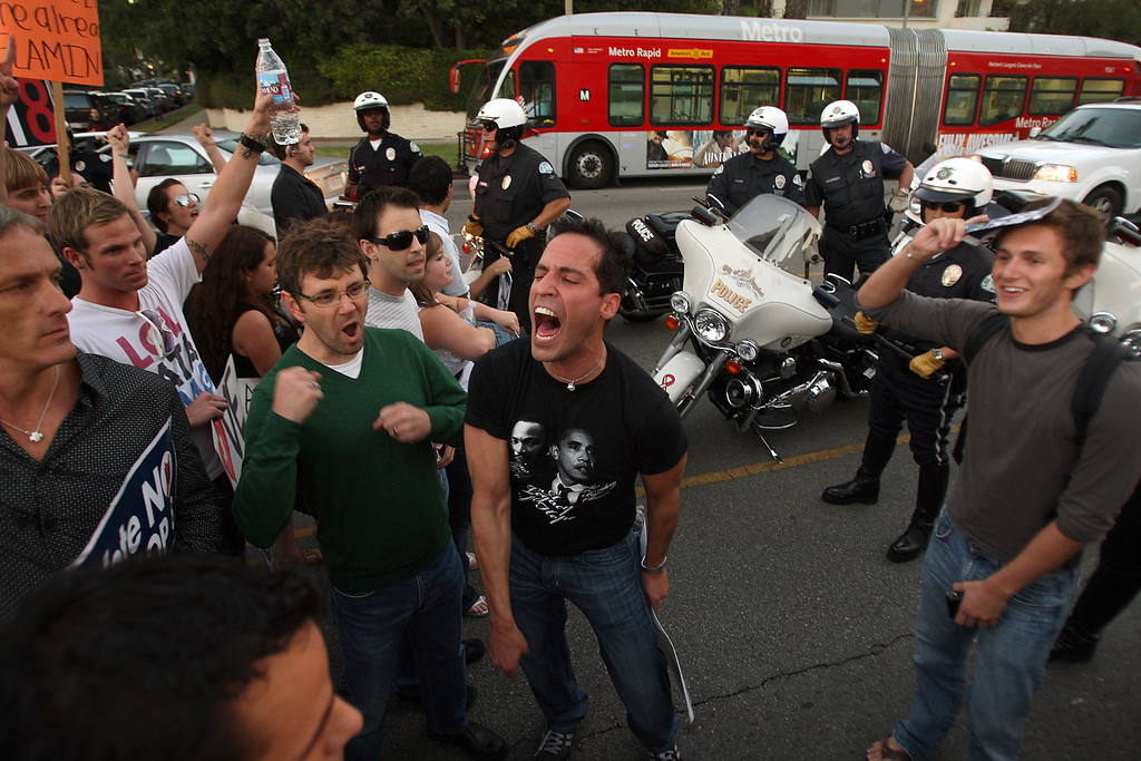 . LOS ANGELES, CA - NOVEMBER 6:  Hundreds of supporters of same-sex marriage march for miles in protest against the Church of Jesus Christ of Latter-day Saints November 6, 2008 in Los Angeles, California. The protest, which began outside the Los Angeles Mormon temple, opposes massive financial contributions to the Proposition 8 campaign, which voters passed and which changes the California Constitution to make gay marriage illegal. When same-sex marriages became legal in California on June 16, conservative churches vowed to fight it and successfully passed Proposition 8 with funds that dwarfed that of their opponents. Demonstrators say the Mormon Church contributed some $35 million to pass the measure.  (Photo by David McNew/Getty Images)