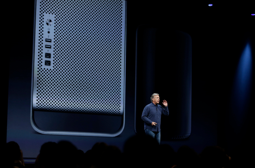 . Phil Schiller the senior vice president of worldwide marketing at Apple introduces the new Mac Pro during the keynote address of the Apple Worldwide Developers Conference Monday, June 10, 2013 in San Francisco. (AP Photo/Eric Risberg)