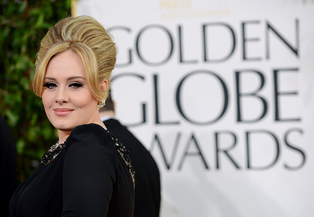 Description of . Singer Adele arrives at the 70th Annual Golden Globe Awards at the Beverly Hilton Hotel on Sunday Jan. 13, 2013, in Beverly Hills, Calif. (Photo by Jordan Strauss/Invision/AP)