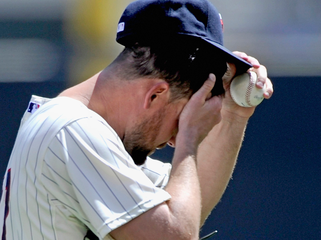 . Twins starter Mike Pelfrey rubs his head after giving up three straight hits  without recording an out in the fifth inning. Pelfrey was lit up for five earned runs on eight hits before being removed from the game.   (Photo by Hannah Foslien/Getty Images)