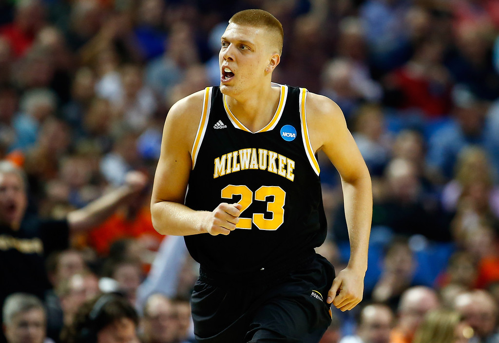 . BUFFALO, NY - MARCH 20: J.J. Panoske #23 of the Milwaukee Panthers reacts after hitting a shot against the Villanova Wildcats during the second round of the 2014 NCAA Men\'s Basketball Tournament at the First Niagara Center on March 20, 2014 in Buffalo, New York.  (Photo by Jared Wickerham/Getty Images)