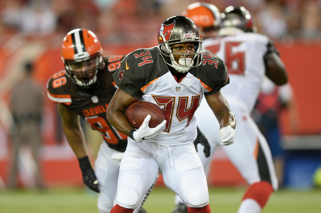 . Tampa Bay Buccaneers running back Charles Sims (34) runs against the Cleveland Browns during the first quarter of an NFL football game Friday, Aug. 26, 2016, in Tampa, Fla. (AP Photo/Jason Behnken)