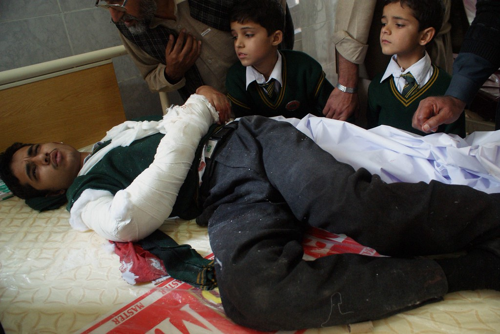 . An injured Pakistani student lies on a bed at a hospital following an attack by Taliban gunmen on a school in Peshawar on December 16, 2014.  Taliban insurgents killed at least 130 people, most of them children, after storming an army-run school in Pakistan December 16 in one of the country\'s bloodiest attacks in recent years.  AFP PHOTO/ A  Majeed/AFP/Getty Images