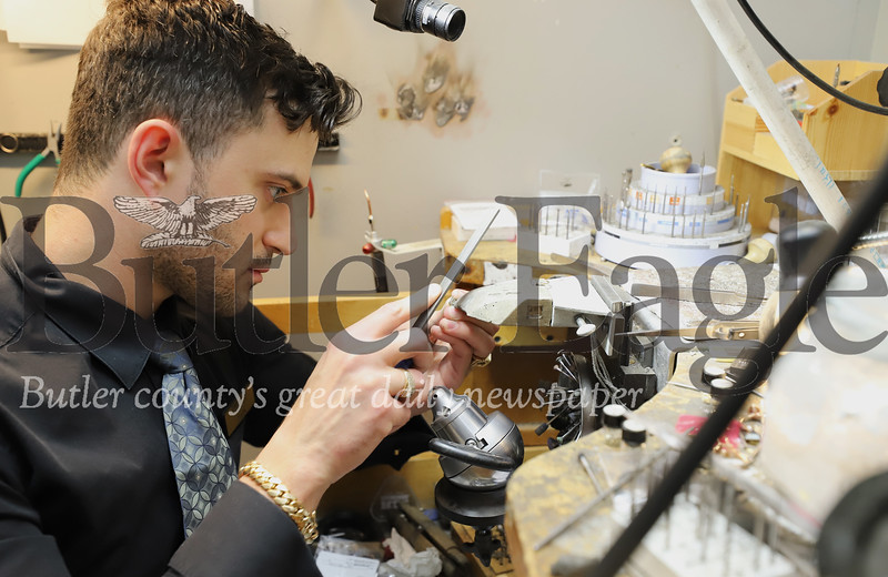 Zach Emigh of Emigh Jewelry Co. works on a piece of jewelry. Seb Foltz/Butler Eagle