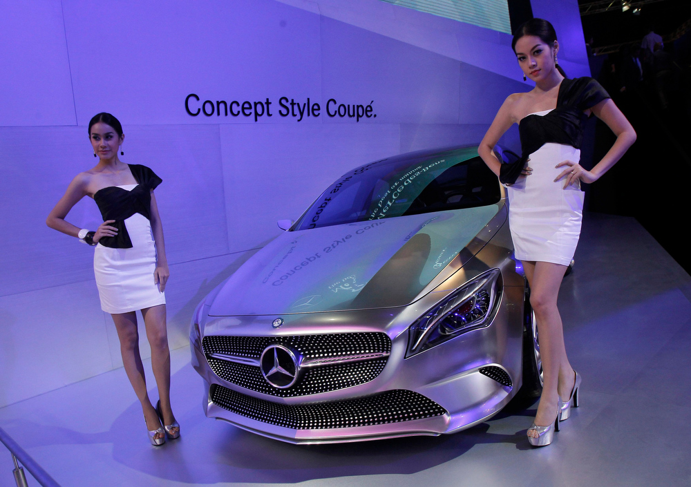 . Models pose beside a Mercedes-Benz Concept Style Coupe during a media presentation of the 34th Bangkok International Motor Show in Bangkok March 26, 2013. The Bangkok International Motor Show will be held from March 27 to April 7. REUTERS/Chaiwat Subprasom
