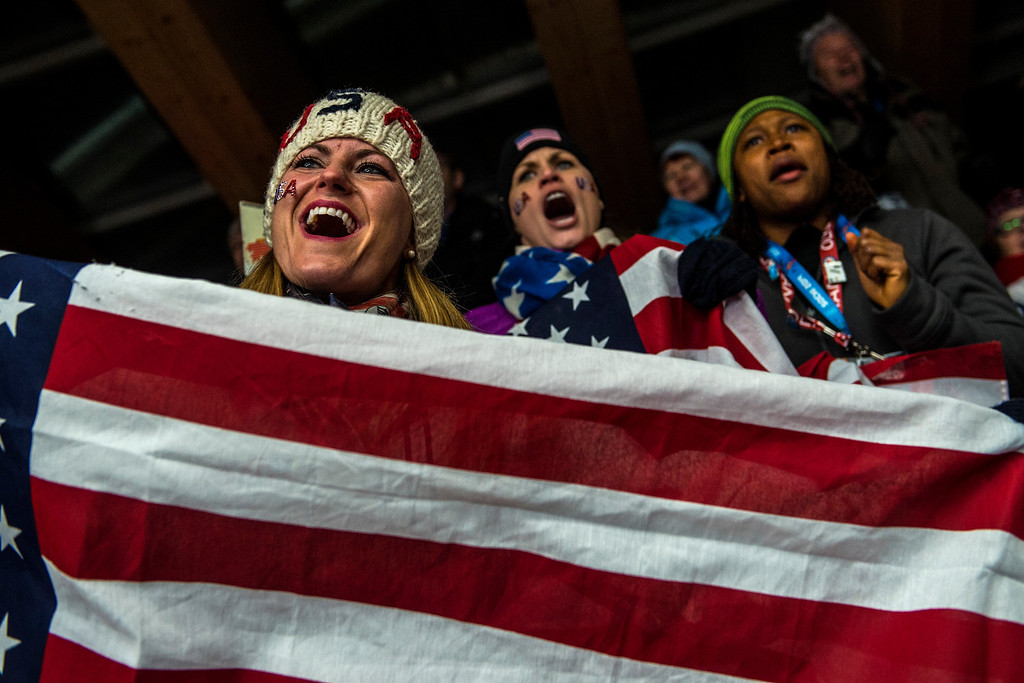 . KRASNAYA POLYANA, RUSSIA  - JANUARY 14: Skeleton athletes Blair Tomten, Morgan Tracey and bobsled athlete Lauryn Williams cheer on fellow American Katie Uehlander, of Breckenridge, Colo., as she competes during the women\'s skeleton competition at Sanki Sliding Center during the 2014 Sochi Olympics Friday February 14, 2014. Uehlander finished in fourth place with a time of 3:54.34. (Photo by Chris Detrick/The Salt Lake Tribune)