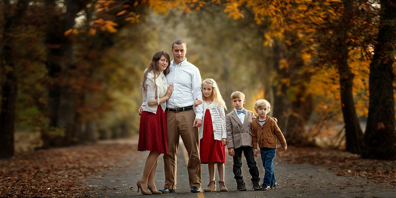 Sacramento family photographer during outdoor portrait session. Fall Family pictures in a park