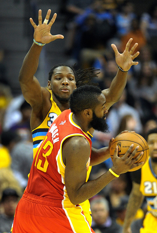 . DENVER, CO. - APRIL 6: Kenneth Faried (35) of the Denver Nuggets smothered James Harden (13) of the Houston Rockets in the second half. The Denver Nuggets defeated the Houston Rockets 132-114 at the Pepsi Center Saturday night, April 6, 2013. Photo By Karl Gehring/The Denver Post)