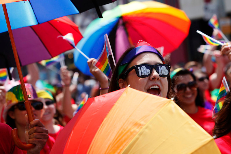 . People carry umbrellas as they take part in the 43rd annual LA LGBT Pride Parade in West Hollywood, California June 9, 2013. The parade celebrates the lesbian, gay, bisexual and transgender (LGBT) communities in Los Angeles. REUTERS/Patrick T. Fallon