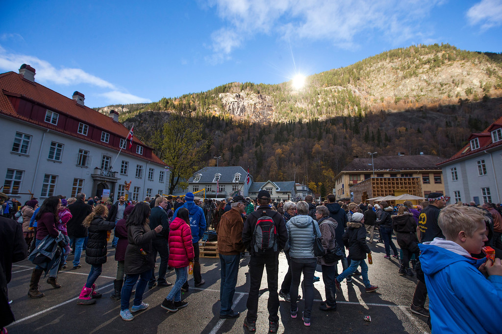 . A crowd forms, those in the centre bathing in sunlight, for the official opening of giant sun mirrors in the town of Rjukan, Norway, Wednesday, Oct. 30, 2013.  (AP Photo/NTB Scanpix, Terje Bendiksby)