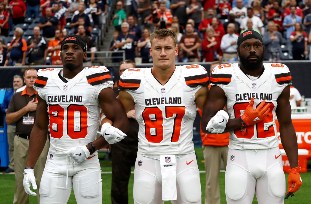 . Cleveland Browns\' Ricardo Louis (80), Seth DeValve (87) and Kasen Williams (82) interlock arms during the playing of the national anthem before an NFL football game against the Houston Texans, Sunday, Oct. 15, 2017, in Houston. (AP Photo/Eric Gay)