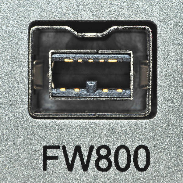 """Close-up of a Firewire 800 port on an external hard drive.    At 300 dot-per-inch resolution (for high quality prints), this image is 9"""" x 7-3/4""""; for web use (72dpi), it is over 14"""" x 14""""."""