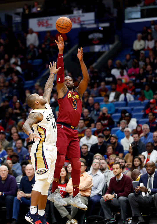 . Cleveland Cavaliers guard Dwyane Wade (9) shoots over New Orleans Pelicansguard Jameer Nelson (14) in the first half of an NBA basketball game in New Orleans, Saturday, Oct. 28, 2017. (AP Photo/Gerald Herbert)