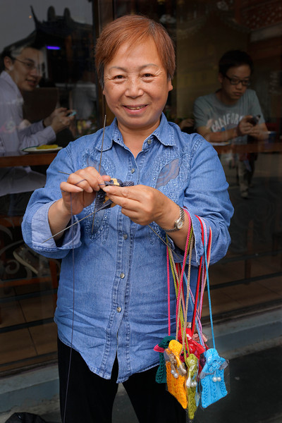 We bought a purse knitted by this entrepreneur in Old Shangai near Yu Garden