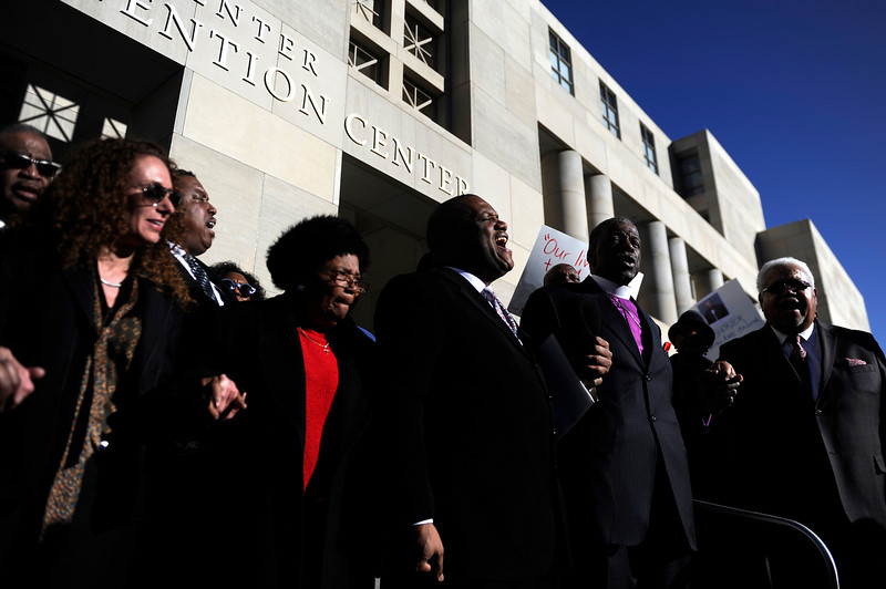 . Timothy E. Tyler (center) of The African Methodist Episcopal Church sings with the crowd during a rally seeking justice for Marvin Lewis Booker, who was killed during an altercation with deputies while being booked on charges of possession of drug paraphernalia in 2010. Denver Detention Center on Wednesday, March 12, 2014. (Photo By AAron Ontiveroz/ The Denver Post)