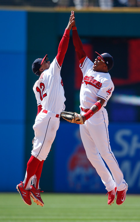 . Cleveland Indians\' Francisco Lindor (12) and Greg Allen celebrate a victory over the New York Yankees in a baseball game, Sunday, July 15, 2018, in Cleveland. (AP Photo/Ron Schwane)